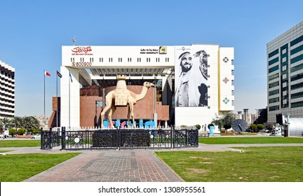 Dubai, United Arab Emirates – February 13, 2018: Exterior view of the Municipality Building on the Creek side with a camel statue in front.