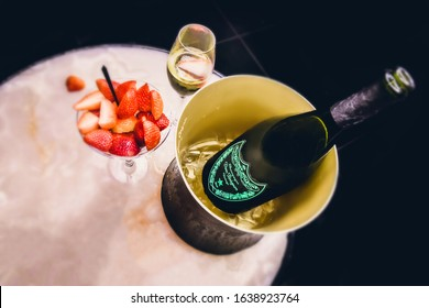 Dubai, United Arab Emirates, February 2020 - Champagne dom perignon vintage brut, Champagne bucket with strawberry and champagne glass on the restaurant table celebration