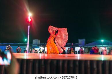 DUBAI, UNITED ARAB EMIRATES - FEBRUARY 24 2017 : Belly dancer doing her performance in desert safari camp, Dubai, UAE.