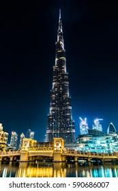 Dubai, United Arab Emirates - February 8 - View of Burj Khalifa and a bridge at night on February 8, 2017.
