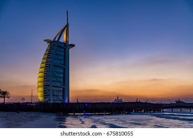 Dubai, United Arab Emirates - February 7, 2017 - View of Burj Al Arab hotel at sunset, horizontal