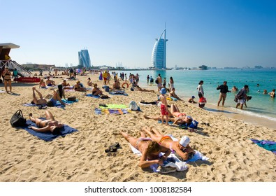 DUBAI, UNITED ARAB EMIRATES - JAN 02, 2018: Public beach of Dubai near the Burj Al Arab hotel.
