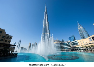 DUBAI, UNITED ARAB EMIRATES - JAN 02, 2018: Fountainshow in front of the Burj Khalifa in the center of Dubai, it is the tallest building in the world with 828 meters high.