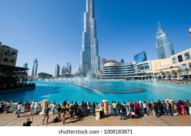 DUBAI, UNITED ARAB EMIRATES - JAN 02, 2018: Tourists are watching the fountainshow in front of the Burj Khalifa in the center of Dubai.