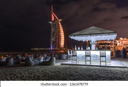 Dubai, United Arab Emirates - January 15, 2018: Beautiful beach bar overlooking the Burj Al Arab Hotel.