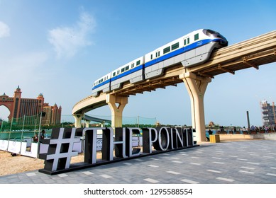 Dubai, United Arab Emirates - January 25, 2019: Train running above The Pointe waterfront dining and entertainment destination newly opened at the Palm Jumeirah