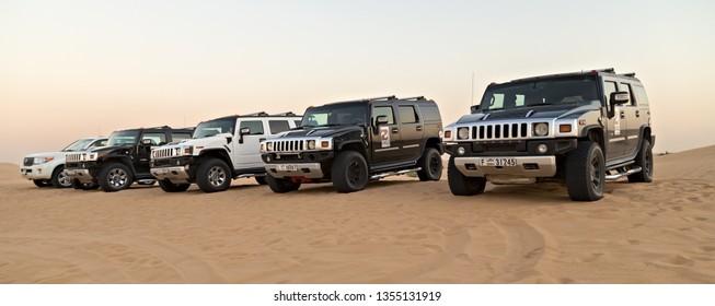 DUBAI, UNITED ARAB EMIRATES - JANUARY 25, 2016: Safari Hummer H2 rally off road vehicle sand desert landscape, UAE, Dubai.