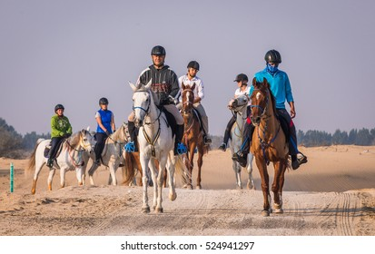 Dubai, United Arab Emirates, January  16th, 2016: horseriders in a desert