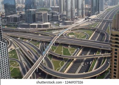 Dubai, United Arab Emirates - July 20, 2018: Aerial view of the Sheikh Zayed Junction with multi-storey bridges