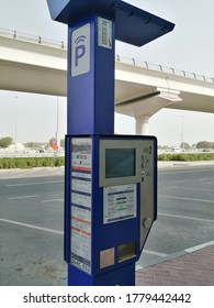 Dubai, United Arab Emirates - July 20, 2020: Hi-tech parking meter of Dubai's Roads & Transport Authority (RTA). The solar-powered smart meter issues motorists with an e-ticket or a paper ticket.