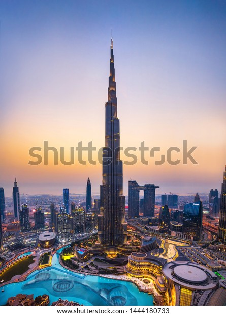 Dubai, United Arab Emirates - July 5, 2019: Burj khalifa rising above Dubai mall and fountain surrounded by modern downtown buildings top view