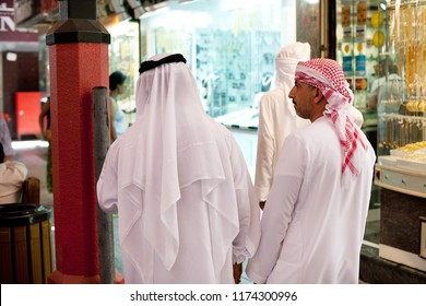 Dubai, United Arab Emirates, June 8, 2013: Two men wearing traditional white robes, known as Kandura, Dubai