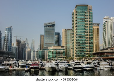 DUBAI, UNITED ARAB EMIRATES - JUNE 25, 2016: Modern skyscrapers and embankment in famous Dubai Marina. Marina - artificial canal city, carved along a 3 km stretch of Persian Gulf shoreline.