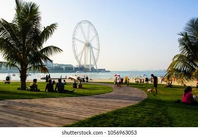 Dubai, United Arab Emirates - March 8, 2018: JBR, Jumeira Beach Resort beach with Ain Dubai ferris wheel emirates future atraction