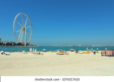 Dubai, United Arab Emirates - March 15, 2018. Jumeirah beach, Dubai marina, vacationing people on the beach.