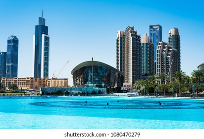 Dubai, United Arab Emirates - March 26, 2018: Dubai Opera and modern Dubai downtown skyscrapers view from Dubai mall at day time
