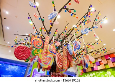 DUBAI, United Arab Emirates - March, 2019: Big tree with  colorfull lollypops and  multicolor sweets in Candylicious shop, the biggest candy store in the world in the Dubai Mall in UAE
