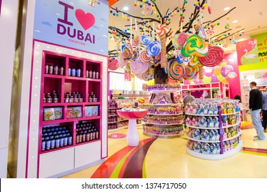 "DUBAI, United Arab Emirates - March, 2019: Entrance to Candylicious shop with Big tree with colorfull lollypops and  multicolor sweets and words ""I love Dubai"" in the Dubai Mall in UAE"