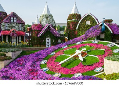Dubai, United Arab Emirates - March 25, 2019: Beautiful flower bed in the form of a peacock with a clock in the middle