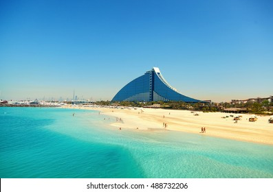 Dubai, United Arab Emirates - March 23, 2011 : Jumeirah Beach hotel with the pure white sand beach and crystal clear water in front of it
