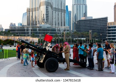 Dubai, United Arab Emirates - May 18, 2018: Ramadan Canon and soldiers in front of Burj Khalifa and the Dubai mall fountain to signal the end of the daily fast in the holy month