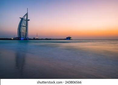 DUBAI, UNITED ARAB EMIRATES - MAY 20, 2013: Burj al-Arab in the evening from Jumeirah Beach, Dubai