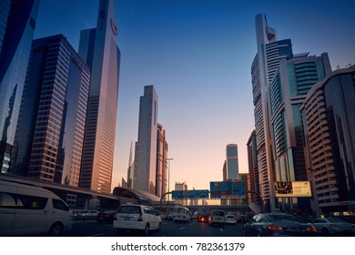 Dubai, United Arab Emirates - May 26 2017: View on modern skyscrapers and busy evening highways day to night transition. Dubai downtown, sheikh zayed road at sunset.