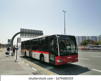 Dubai, United Arab Emirates, Middle East - March 22, 2020: A public transport bus operated by Dubai's Roads and Transport Authority (RTA) awaits passengers at a bus stop in Deira district of the city.
