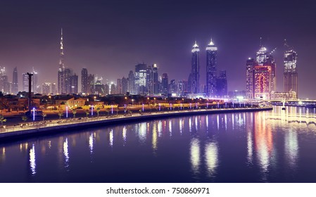 DUBAI, UNITED ARAB EMIRATES - NOV 6, 2017: Night cityscape view from Dubai Water Canal arc bridge