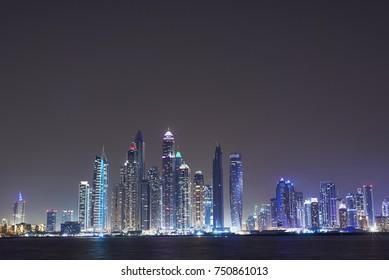 DUBAI, UNITED ARAB EMIRATES - NOV 6, 2017: Night view of the dubai marina skyscraper from the palm Dubai