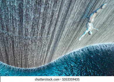 Dubai, United Arab Emirates - Nov.30, 2016: Giant Fountain with Flying Sculpture of an Diver in Dubai Mall. The Fountain Dedicated to the Extraction of Pearls