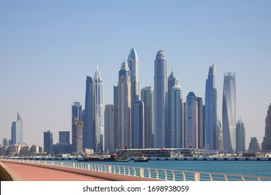 DUBAI, UNITED ARAB EMIRATES - NOVEMBER 22, 2019: Dubai Marina skyline and promenade in a sunny day, blue sky in Dubai