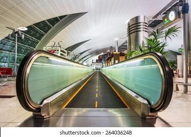 DUBAI, UNITED ARAB EMIRATES - NOVEMBER 7, 2009: Futuristic interior of international airport of Dubai. Dubai airport has a maximum capacity of 60 million passengers, 2.1 million tons of cargo per year