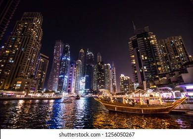 Dubai, United Arab Emirates - October, 2018: Skycrapers at Dubai Marina. Dubai marina at night night cityscape lights