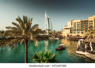 Dubai, United Arab Emirates - October 12, 2018: The Burj Al Arab Hotel on the beach near Madinat Jumeriah Resort. The Burj Al Arab is a luxury hotel located in Dubai, United Arab Emirates.