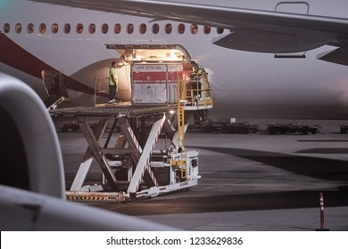 DUBAI, UNITED ARAB EMIRATES - SEPTEMBER 6, 2018: Emirates Boeing 777 Airliner ground handling at Dubai Internation Airport, loading unit load devices into the cargo hold.