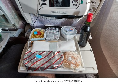 DUBAI, UNITED ARAB EMIRATES - SEPTEMBER 6, 2018: Food served on economy class on an Emirates flight from Dubai to Tokyo. Emirates provides one of the best service among airlines