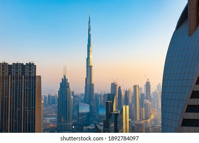 Dubai, United Arab Emirates - September 21, 2020: Burj Khalifa rising above Dubai downtown cityscape high angle view view at sunset. United Arab Emirates modern architecture and travel abstract