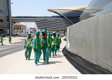 DUBAI, UNITED ARAB EMIRATES - SEPTEMBER 20, 2014 - A group of construction workers  are returning to work after a short break during the day in Dubai, United Arab Emirates.