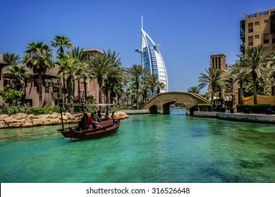 DUBAI, UNITED ARAB EMIRATES - SEPTEMBER 10, 2015: View of Burj Al Arab hotel from Madinat Jumeirah hotel. Madinat is a luxury resort which includes hotels and souk covering an area over 40 hectars.