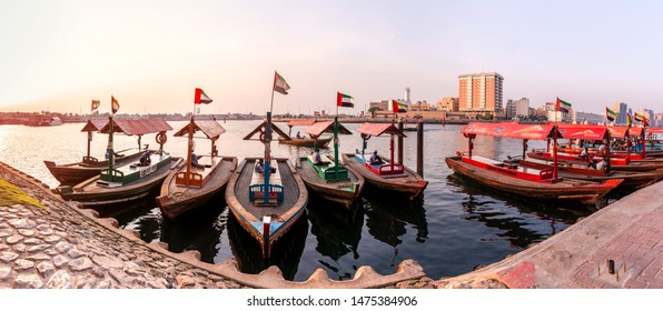 Dubai, United Arab Emirates/8/2/2019 -Creek side Traditional Abra Boat on the bay panoramic view of Old Dubai Transportation