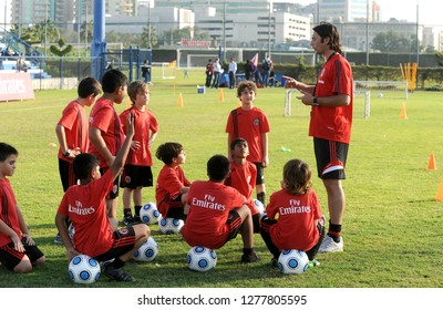 DUBAI, UNITED ARAB EMIRATES-JANUARY 02, 2008: coach teaching soccer at young players during the AC Milan soccer junior camp, in Dubai.