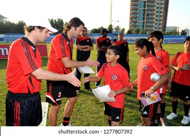 DUBAI, UNITED ARAB EMIRATES-JANUARY 02, 2008: coaches release certificates at the end of the AC Milan soccer junior camp for boys and girls, in Dubai.