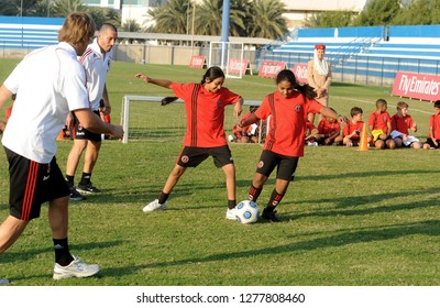 DUBAI, UNITED ARAB EMIRATES-JANUARY 02, 2008: 2 girls playing soccer during the AC Milan soccer junior camp for boys and girls, in Dubai.