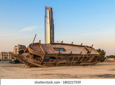 Dubai, United Arabian Emirates, 3.1.2020. Modern city with old heritage: Old Dhow wrecks in al Jaddaf (ship builing area of Dubai) with D1 Tower (at Al Jaddaf Waterfront) in Background  Sunddowner.