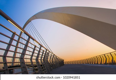 Dubai Water Canal Bridge New Attraction of Dubai City, place to visit in UAE, modern architectur design, beautiful sunset