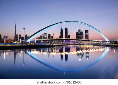 Dubai water canal at sun rise and colorful  bridge as viewed Dubai, United Arab Emirates on November 2017