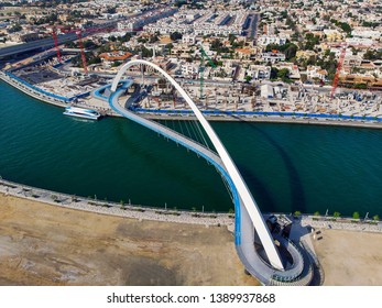 Dubai water canal tolerance bridge over the creek aerial view