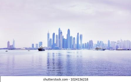 Dubai waterfront skyline, color toning applied, United Arab Emirates.