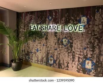 Dubai,Dubai/U.A.E. - November 2018: Eat, Share, Love Encryption on the Restaurant Wall